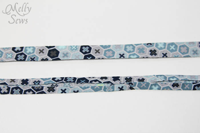 Front and back view of single fold bias tape - How to Make Continuous Bias Tape - Melly Sews