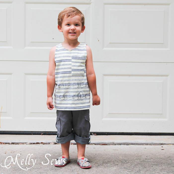 Smiling and wearing Coastal Cargos Convertible Pants PDF Sewing Pattern by Blank Slate Patterns
