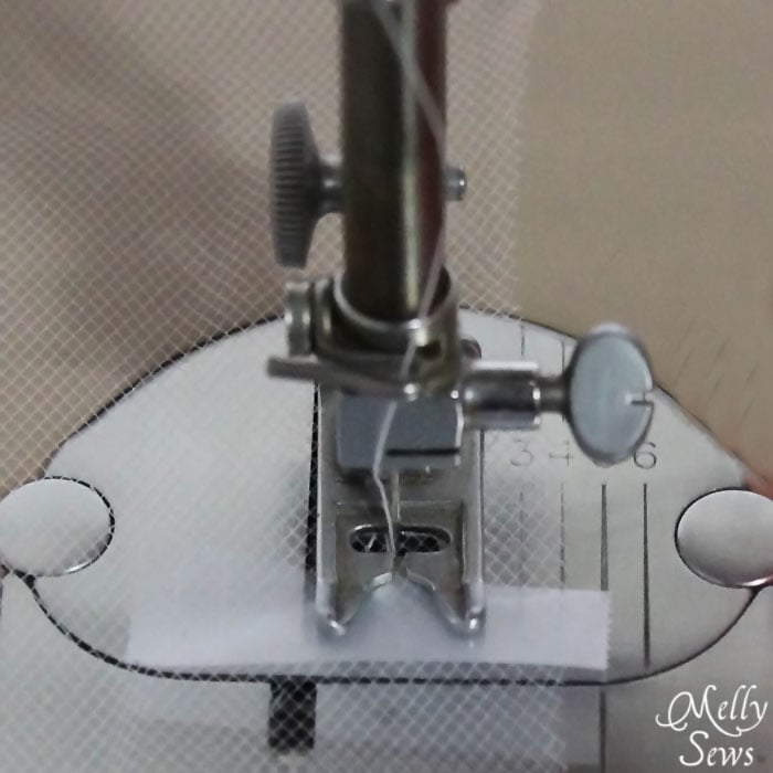 Transparent Tape on your presser foot helps prevent tulle snags - Melly Sews