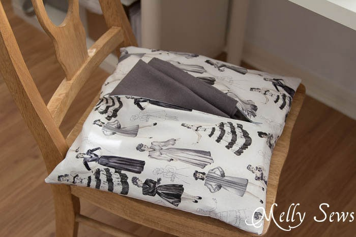A chair cushion conceals fabric scraps - MellySews.com