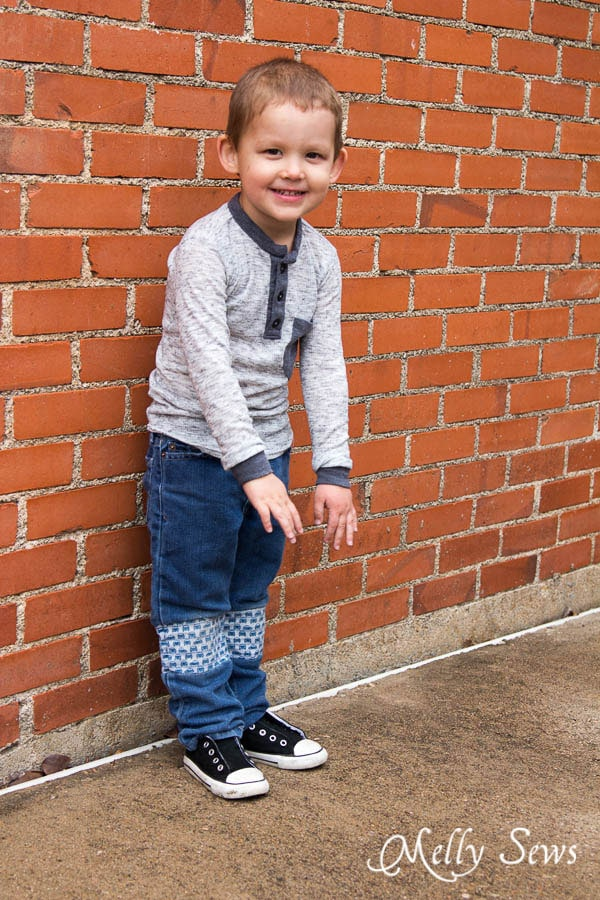 Mend holes in knees in kid jeans - How to Patch Jeans - An easier way to mend knees with holes - MellySews.com