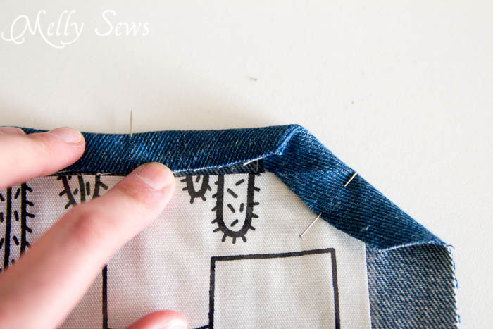 Fold a mitered corner on a placemat