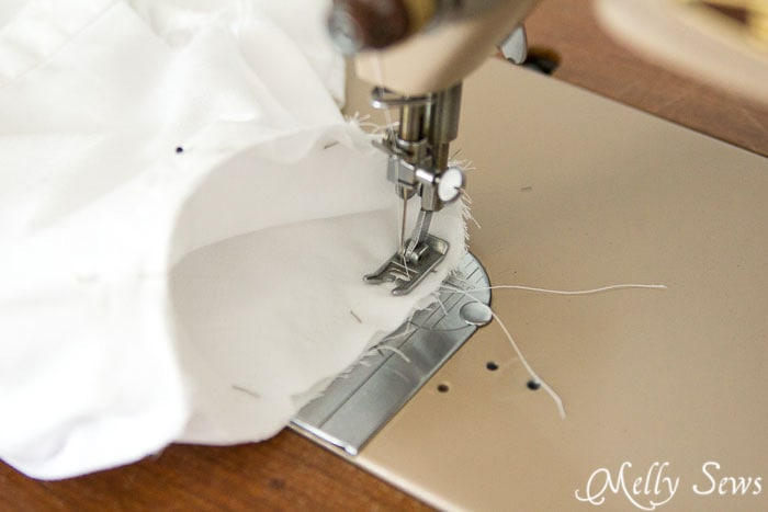 Put your needle inside the sleeve - How to sew a set in sleeve - http://mellysews.com