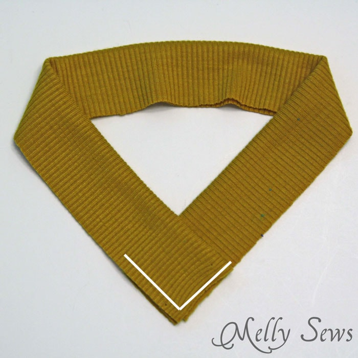How to sew a V neck - overlap binding to form the V - http://mellysews.com