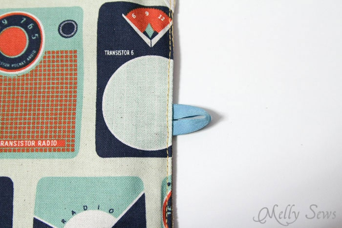 STep 8 - insert loop of elastic for button, then sew 3 edges closed - Book Style iPad Case Tutorial by https://mellysews.com