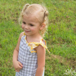 The bows on the shoulders are adorable - Super Simple and Free Girls Dress pattern by mellysews.com