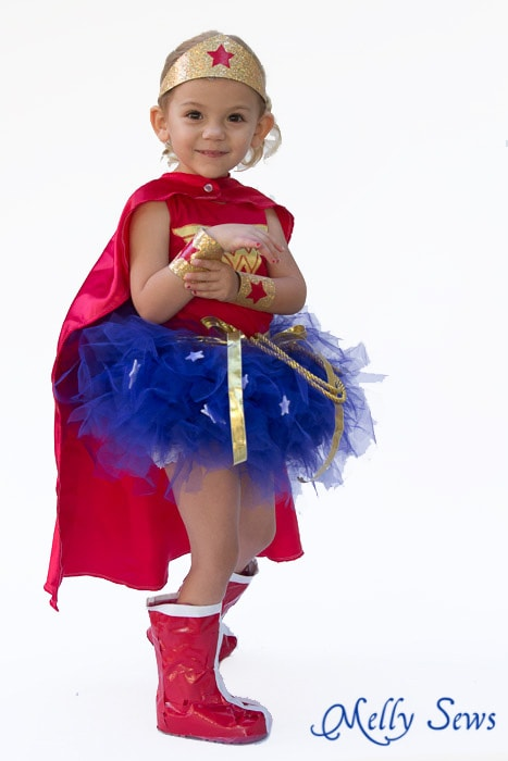 Based on the classic DC superhero, this kids Wonder Woman costume reimagines the costume in tutu costume for your little girl. It has her signature emblem on the front along with the heroic red, blue and gold colors from the comic books.