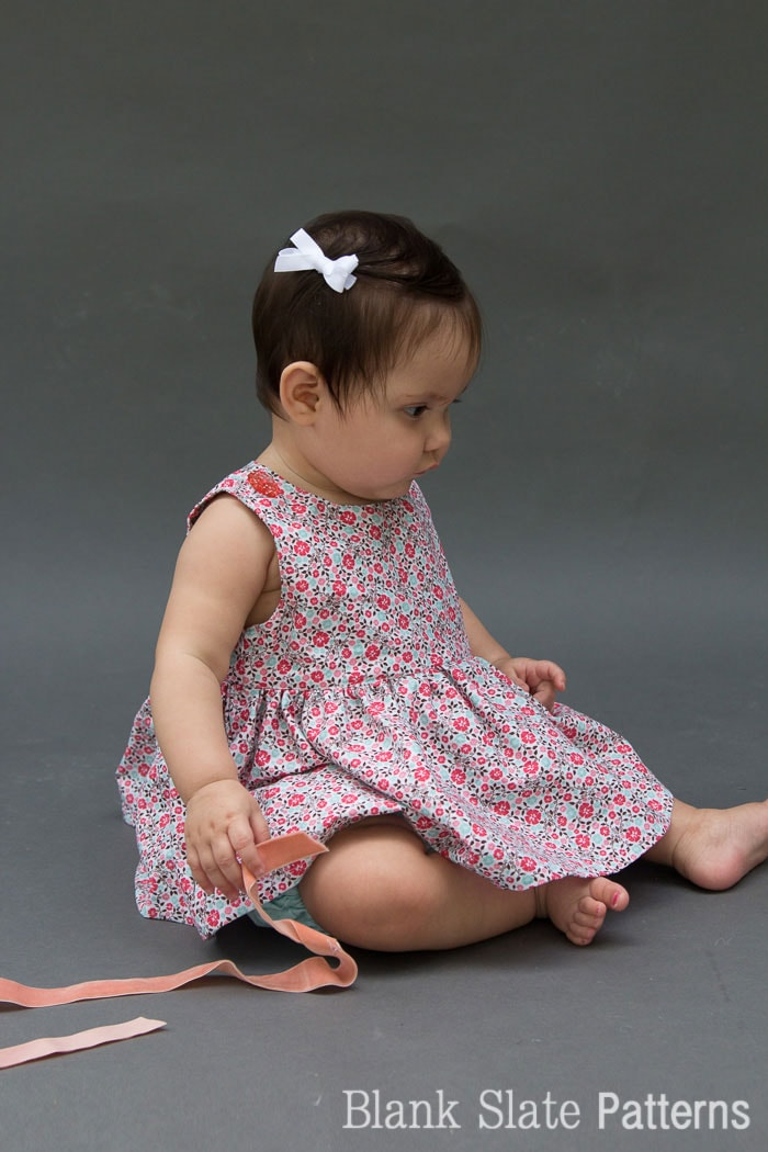 Easy Baby Dress - I can think of so many fabrics to use for this! - Super cute button shoulders - Sew a Baby Dress with a Free Pattern - Melly Sews