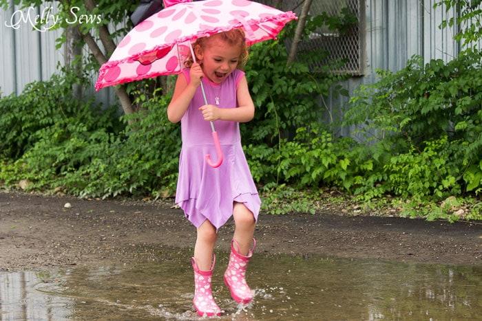 Splashing in puddles - Handkerchief Hem Dress tutorial - Sew a knit girls dress with this free pattern - Melly Sews