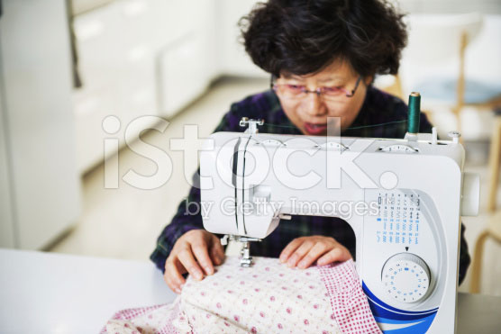 stock-photo-39744578-housewife-and-sewing-machine