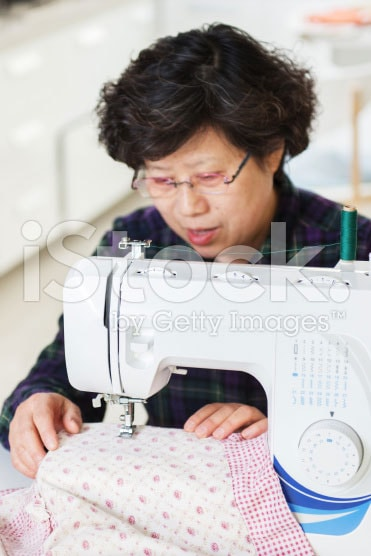 stock-photo-39744788-housewife-and-sewing-machine