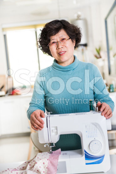 stock-photo-39823676-housewife-and-sewing-machine