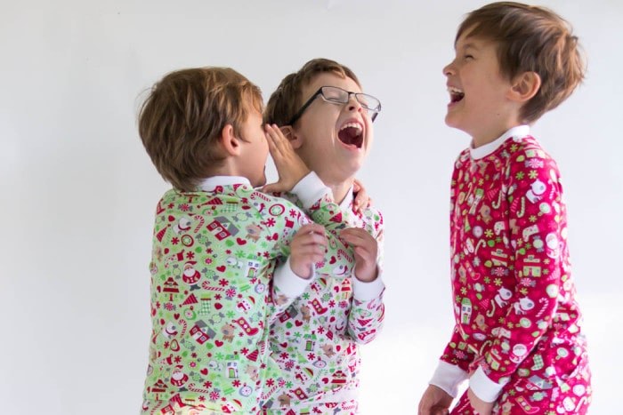 Little boys having fun in their custom pajamas - DIY Sew knit kids Christmas pajamas - with FREE pattern! - Melly Sews