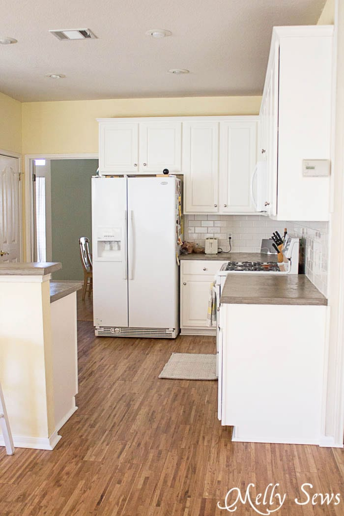 After - White cabinets, gray counters and hardwood floors - White Kitchen Makeover on a budget - DIY remodel from dull and dated to white and bright - Melly Sews
