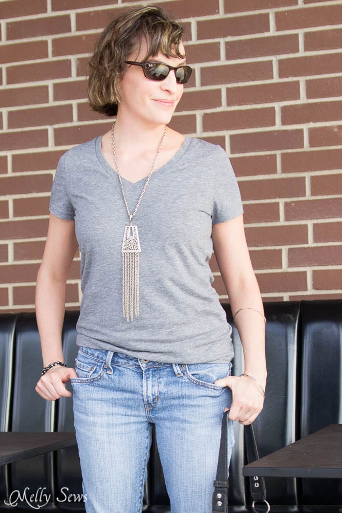 Gray T-shirt, tassel necklace and faded jeans - Turn a pair of thrifted jeans into a perfect fit - Flare jeans to skinny jeans - DIY Tutorial by Melly Sews