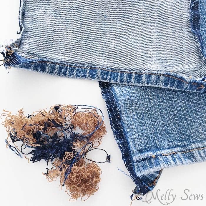 Seam ripped denim jeans