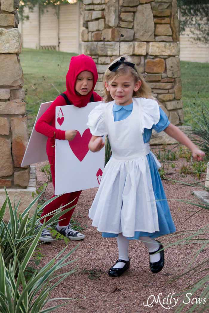 Alice Chased by a Card Soldier - Alice in Wonderland Costume - Sew a DIY Alice in Wonderland costume with a free pattern and tutorial from Melly Sews