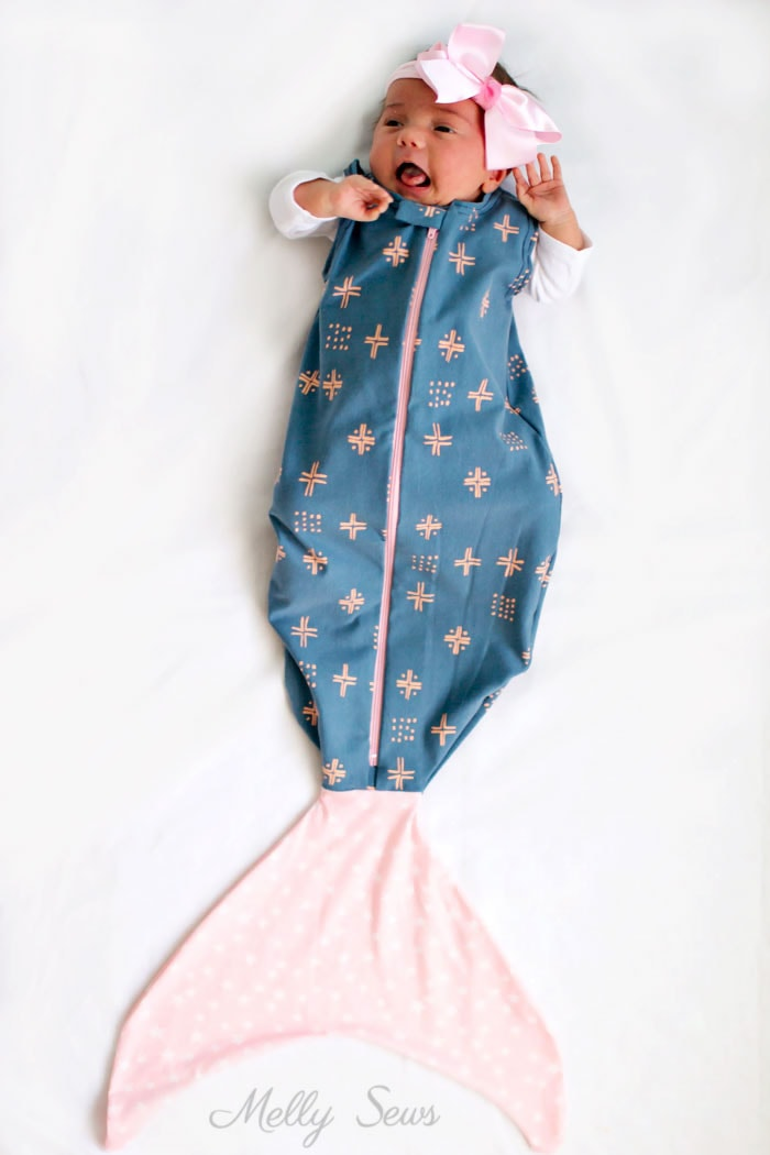 This would be such a great gift - Sew a Mermaid Sleep Sack - a Mermaid blanket for babies! Get the sewing pattern and tutorial including video on Melly Sews
