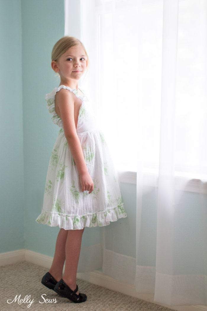 Pretty girls sundress - Sew a Ruffle Strap Pinafore Dress - Apron Dress for Girls - with free pattern and video tutorial on Melly Sews