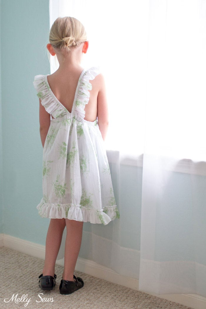 Back view - Sew a Ruffle Strap Pinafore Dress - Apron Dress for Girls - with free pattern and video tutorial on Melly Sews