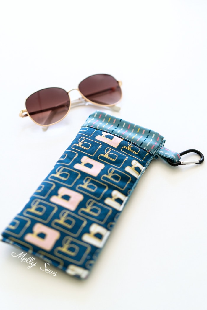 Sew a snap closed glasses case using a measuring tape - no zipper needed and your glasses can't fall out! Melly Sews DIY tutorial