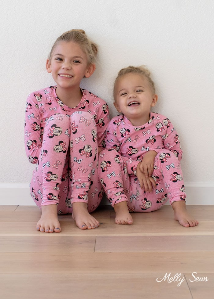Sisters in matching stretchy knit pajama pants - pink Mickey Mouse pajamas