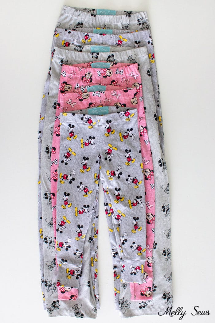 Stack of DIY stretch pajama pants sewn in knit Mickey Mouse fabrics