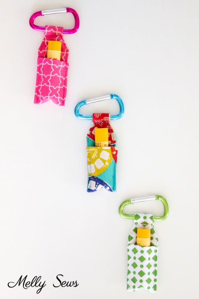 Scrappy sewing project to make keychain chapstick holders in pink, blue and green prints