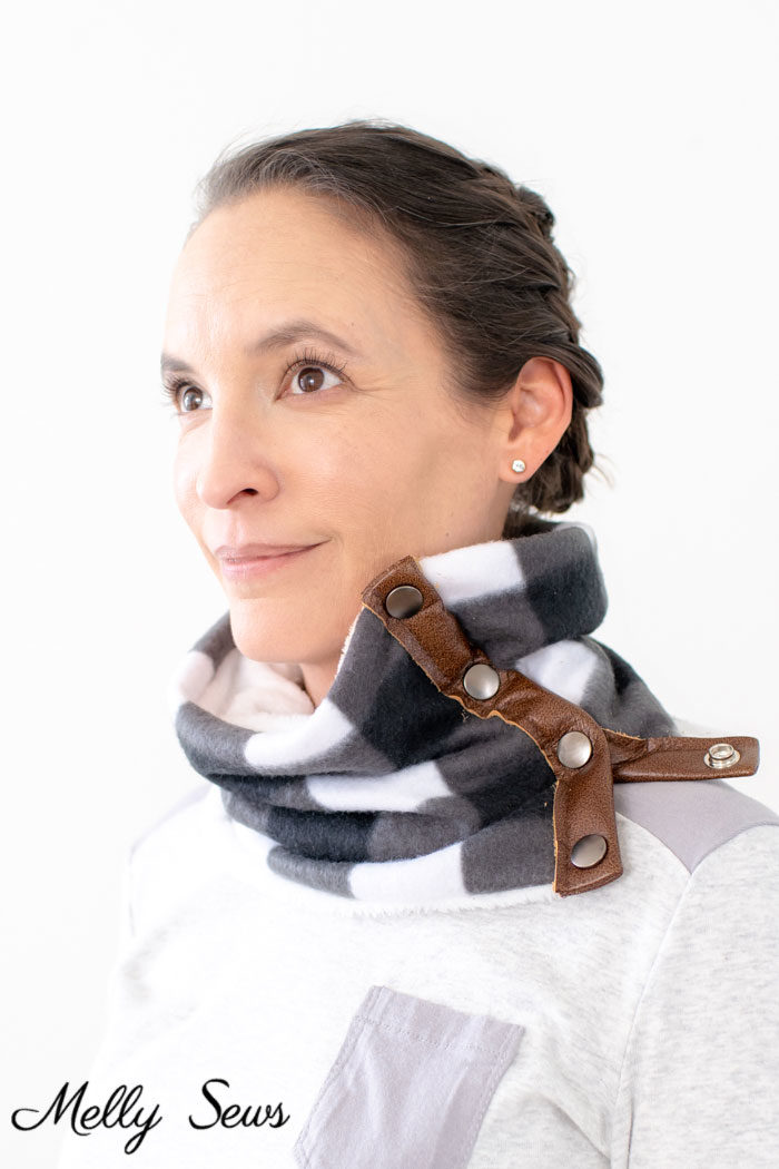Woman wearing a fleece sewing project, a DIY cowl with leather accents and snaps and a tutorial for making it.