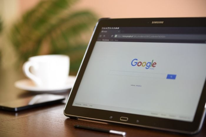 Tablet sitting on table with google search screen loaded
