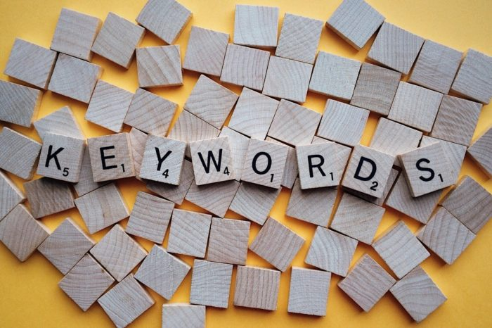 Scrabble tiles spelling out Keywords, an SEO term for beginners.