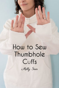 Sew thumbhole cuffs on a sweatshirt to help keep your hands warm.