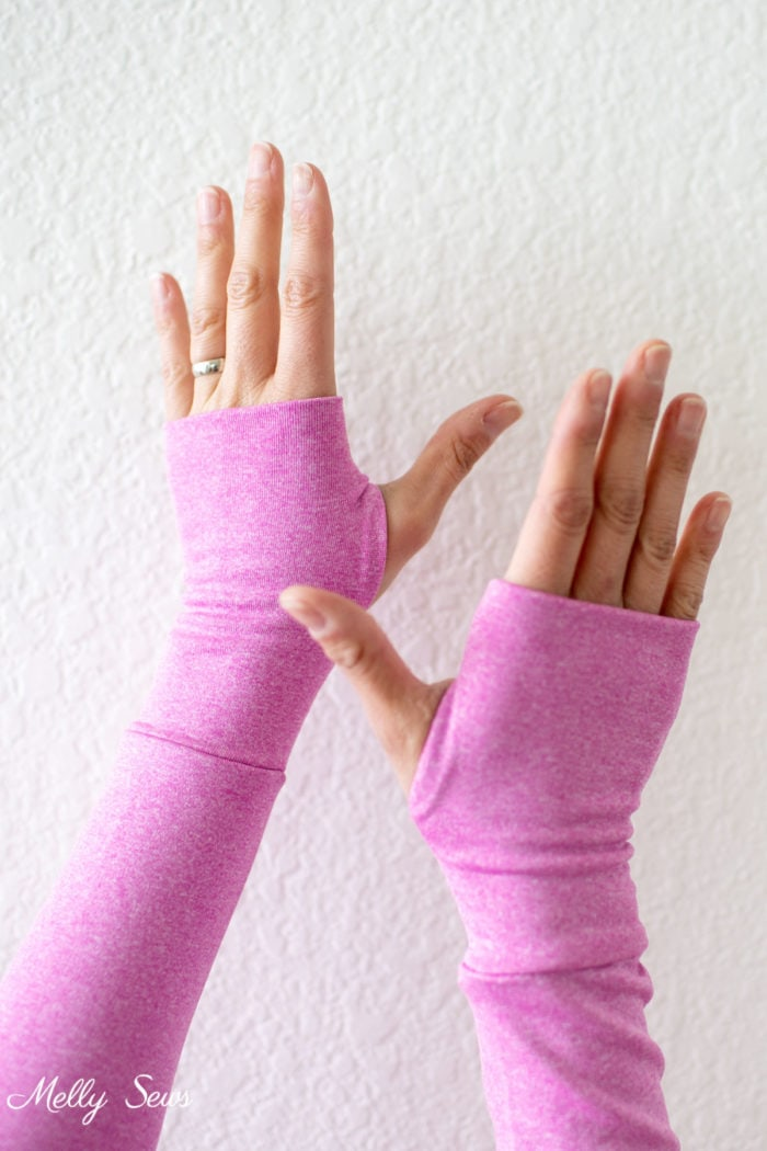 Hands with pink sleeves and thumbhole cuffs
