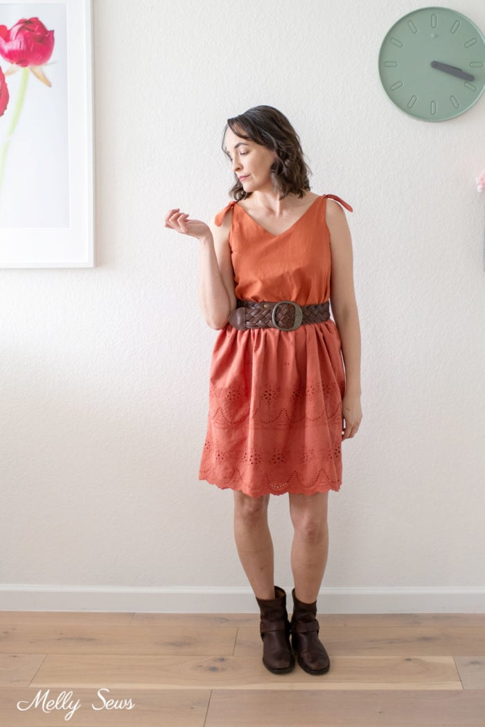 Woman wearing a burnt orange sundress made from a thrifted dress and boots