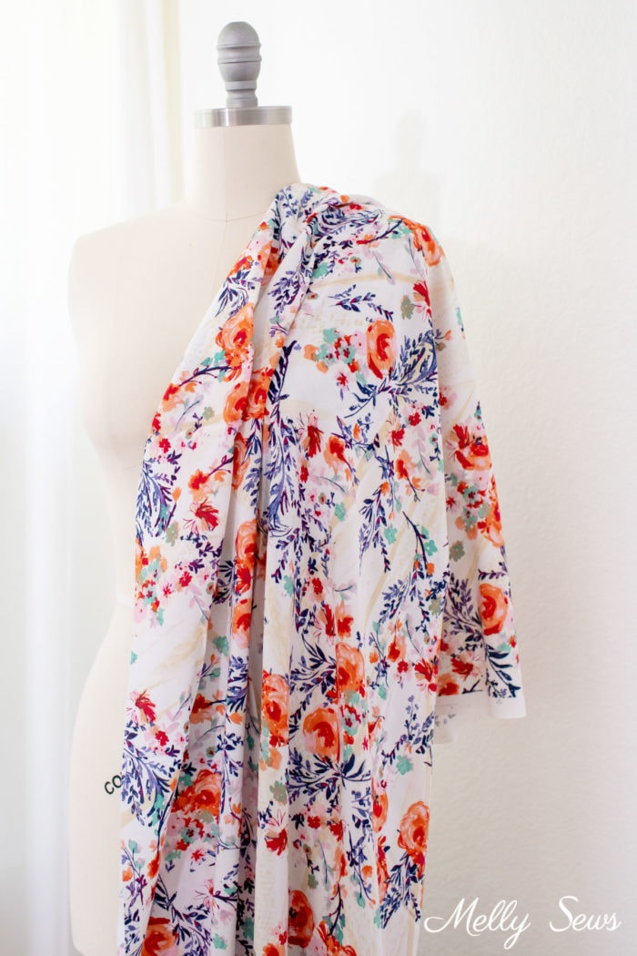 Floral rayon challis fabric draped over a dress form