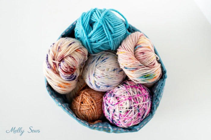 Colorful Balls of Yarn Storage in a DIY Fabric Basket