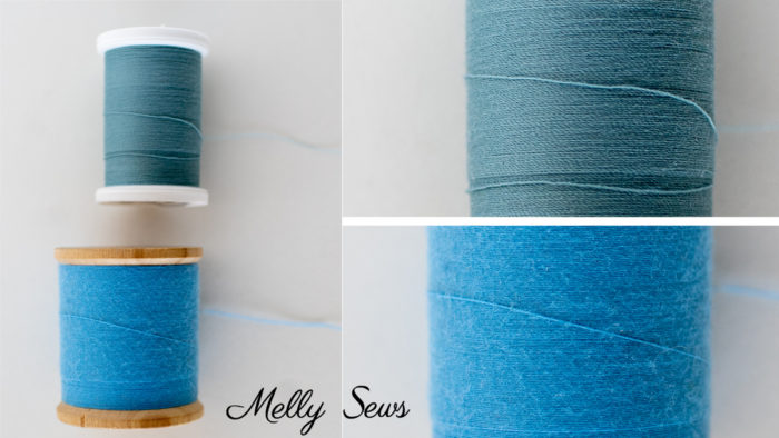 A comparison of modern to vintage sewing thread showing the wear on the older thread