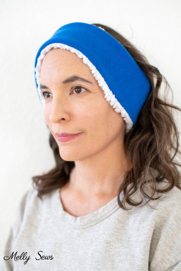 Woman with brown hair wearing an ear warmer headband