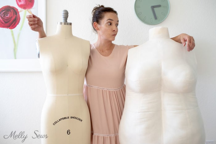 Woman stands between two dress forms - one manufactured and one a DIY plus size form she made