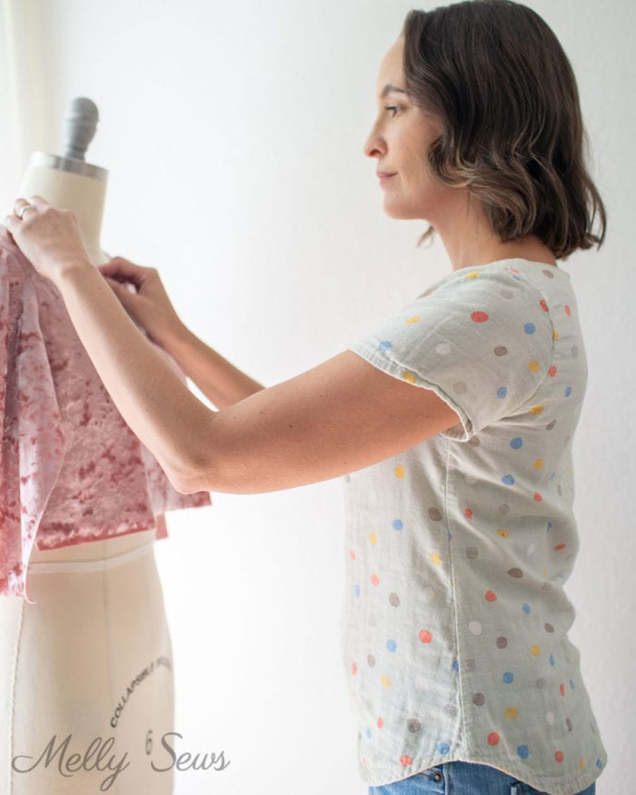 Woman draping a fabric to create a pattern